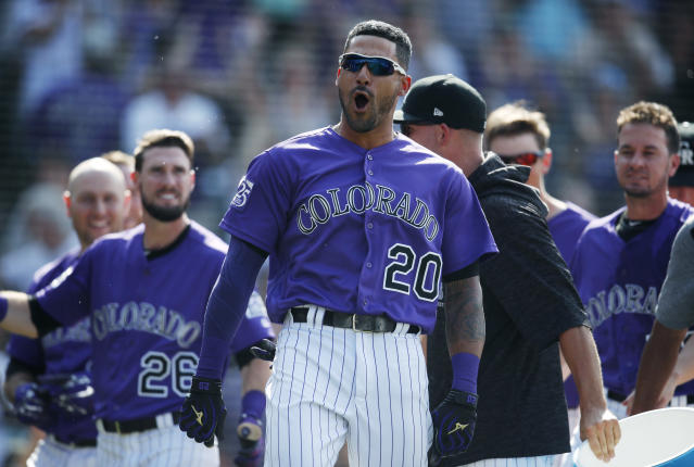Colorado Rockies' Ian Desmond celebrates with teammates after his two-run, walk off home run of San Diego Padres relief pitcher Kirby Yates in the ninth inning of a baseball game Thursday, Aug. 23, 2018, in Denver. The Rockies won 4-3. (AP)