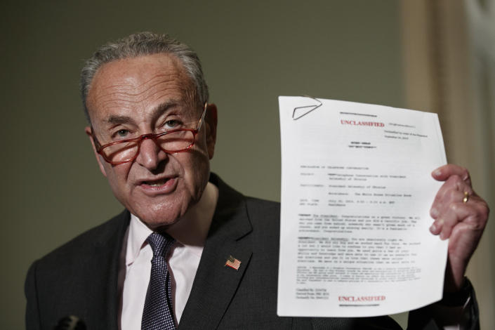 Senate Minority Leader Sen. Chuck Schumer of N.Y. holds up a copy of a White House released rough transcript of a phone call between President Donald Trump and the President of Ukraine as Schumer speaks to the media about an impeachment inquiry on President Trump, Wednesday Sept. 25, 2019, on Capitol Hill in Washington. (Photo: Jacquelyn Martin/AP)