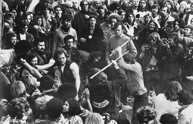 A still from the documentary film 'Gimme Shelter,' showing audience members looking on as Hells Angels beat a fan with pool cues at the Altamont Free Concert, Altamont Speedway, California, Dec. 6, 1969. (Photo: Bill Owens/20th Century Fox/Hulton Archive/Getty Images)