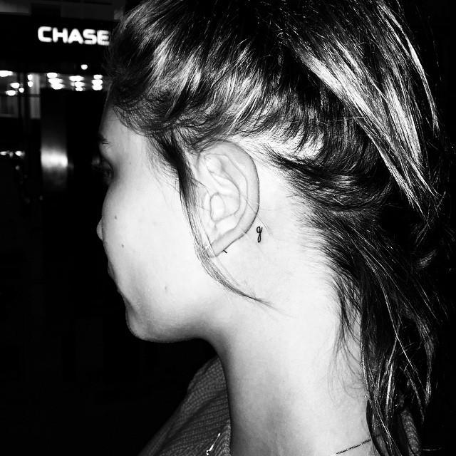 """<p>In 2015, Bieber had the initial 'G' inked on her neck in honour of her pastor Chad Veach's daughter Georgia, who has a rare brain condition called lissencephaly. She was one of several celebrities who got the tattoo along with husband (before they were married) and Ashley Benson, <a href=""""https://people.com/celebrity/hollywood-pastor-daughter-georgia-justin-bieber-hailey-baldwin-tattoo/"""" rel=""""nofollow noopener"""" target=""""_blank"""" data-ylk=""""slk:People"""" class=""""link rapid-noclick-resp"""">People</a> reports.</p><p><a href=""""https://www.instagram.com/p/4BIet6lDIy"""" rel=""""nofollow noopener"""" target=""""_blank"""" data-ylk=""""slk:See the original post on Instagram"""" class=""""link rapid-noclick-resp"""">See the original post on Instagram</a></p>"""