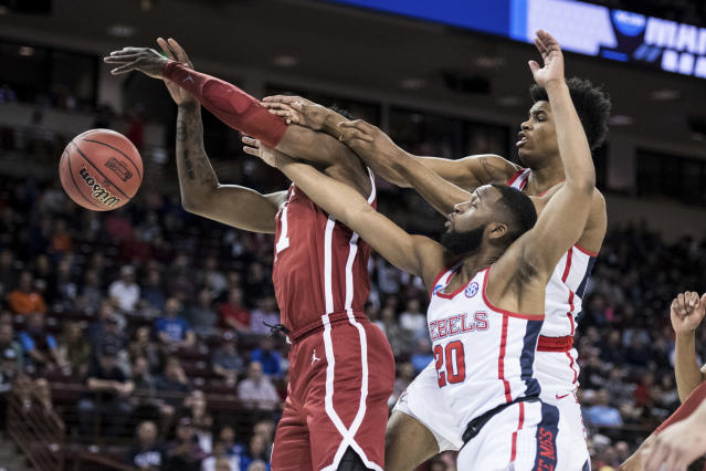 <p>Mississippi guard D.C. Davis (20) and Bruce Stevens, right, battle for a rebound against Oklahoma forward Kristian Doolittle, left, during a first round men's college basketball game in the NCAA Tournament Friday, March 22, 2019, in Columbia, S.C. (AP Photo/Sean Rayford) </p>