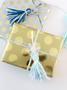 """<p>Cut snowflake shapes from glitter card stock, and pair them with handmade yarn tassels for a gift-wrapping topper that packs a seriously festive punch.</p><p><em><a href=""""https://www.whitehousecrafts.net/post/2018/10/15/yarn-tassel-wrapped-gifts"""" rel=""""nofollow noopener"""" target=""""_blank"""" data-ylk=""""slk:Get the tutorial at White House Crafts"""" class=""""link rapid-noclick-resp"""">Get the tutorial at White House Crafts</a></em></p>"""