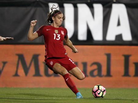 Apr 6, 2017; Frisco, TX, USA; USA forward Alex Morgan (13) controls the ball against Russia at Toyota Stadium. Mandatory Credit: Matthew Emmons-USA TODAY Sports