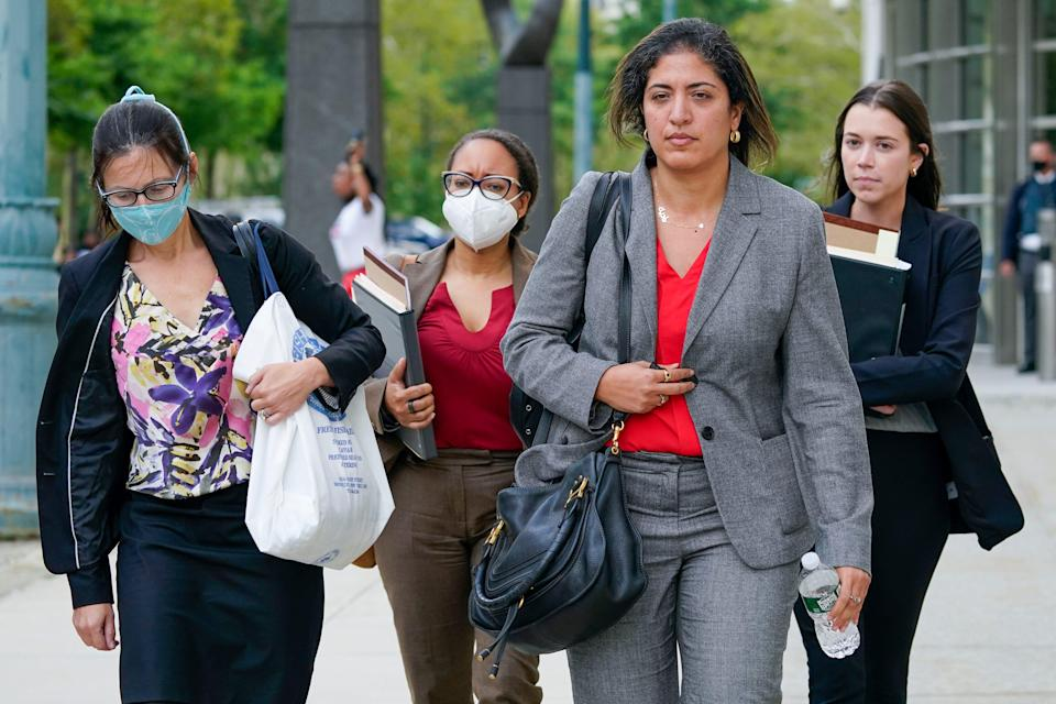 Assistant United States Attorneys Elizabeth Geddes, left, Maria Cruz Melendez, second from left, and Nadia Shihata, second from right, leave court at the end of the third day in R. Kelly's sex-trafficking trial on Aug. 19, 2021, in New York.