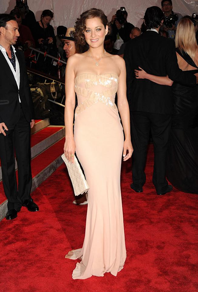 "One of the night's best dressed beauties was undoubtedly Marion Cotillard, who knocked 'em dead in a pale pink Dior ball gown, soft curls, and minimal makeup. Kevin Mazur/<a href=""http://www.wireimage.com"" target=""new"">WireImage.com</a> - May 1, 2009"