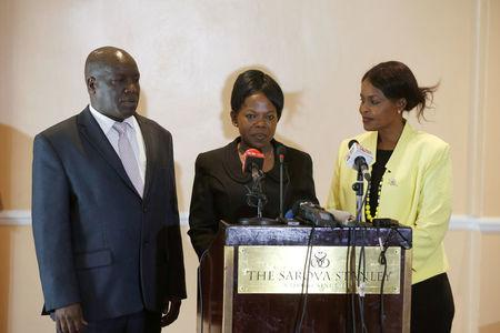 Kenyan commissioners Nkatha Maina, Margaret Mwachanya and Paul Kurgat attend a news conference where they announced their resignation in Nairobi