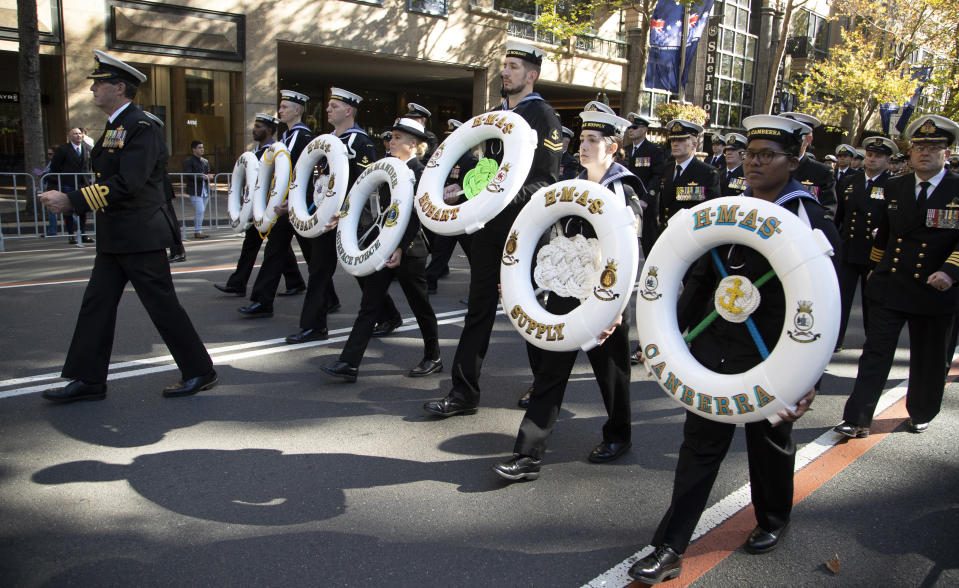 Naval personnel march during the Anzac Day parade in Sydney, Australia, Sunday, April 25, 2021. Australians and New Zealanders paid tribute to their war dead Sunday as both nations prepared to withdraw from their longest war in Afghanistan. (AP Photo/Mark Baker)