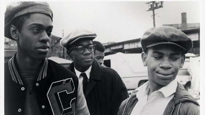 """Lawrence-Hilton Jacobs, Glynn Turman and Corin Rogers stand together outside in a scene in """"Cooley High."""""""