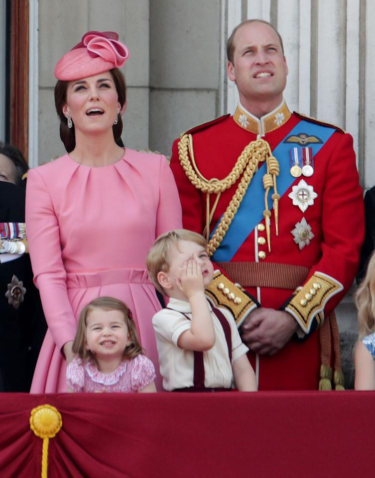 <p>The Duchess appeared with her entire family at the 2017 Trooping of the Colour ceremony. Celebrating the Queen's 91st birthday, Kate chose a summery pink dress by Alexander McQueen. The long-sleeved design had been customised from a sleeveless version and featured ruched detailing at the waist. Requiring a matching hat for any formal occasion, she chose a sculptural style by Jane Taylor.</p><p><i>[Photo: PA]</i></p>