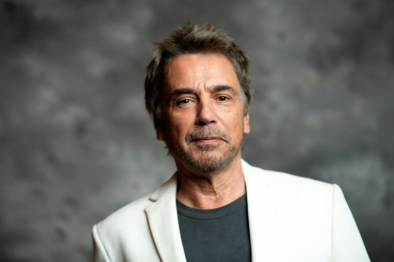 French composer Jean-Michel Jarre is looking for 'total immersion' in Sunday's virtual concert (AFP Photo/VALERIE MACON)