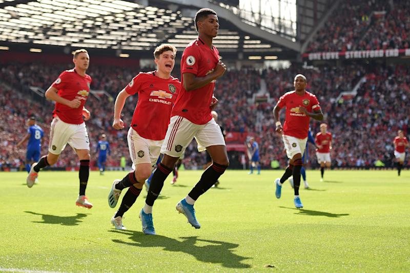Manchester United's English striker Marcus Rashford (C) celebrates with teammates after scoring the opening goal of the English Premier League football match between Manchester United and Leicester City at Old Trafford in Manchester, north west England, on September 14, 2019. (Photo by Oli SCARFF / AFP) / RESTRICTED TO EDITORIAL USE. No use with unauthorized audio, video, data, fixture lists, club/league logos or 'live' services. Online in-match use limited to 120 images. An additional 40 images may be used in extra time. No video emulation. Social media in-match use limited to 120 images. An additional 40 images may be used in extra time. No use in betting publications, games or single club/league/player publications. / (Photo credit should read OLI SCARFF/AFP/Getty Images)