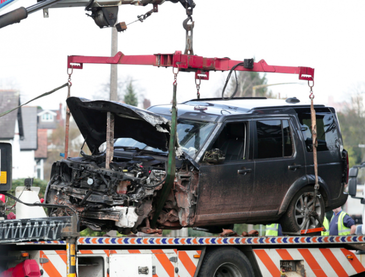 The mangled Land Rover is taken away from the scene (SWNS)