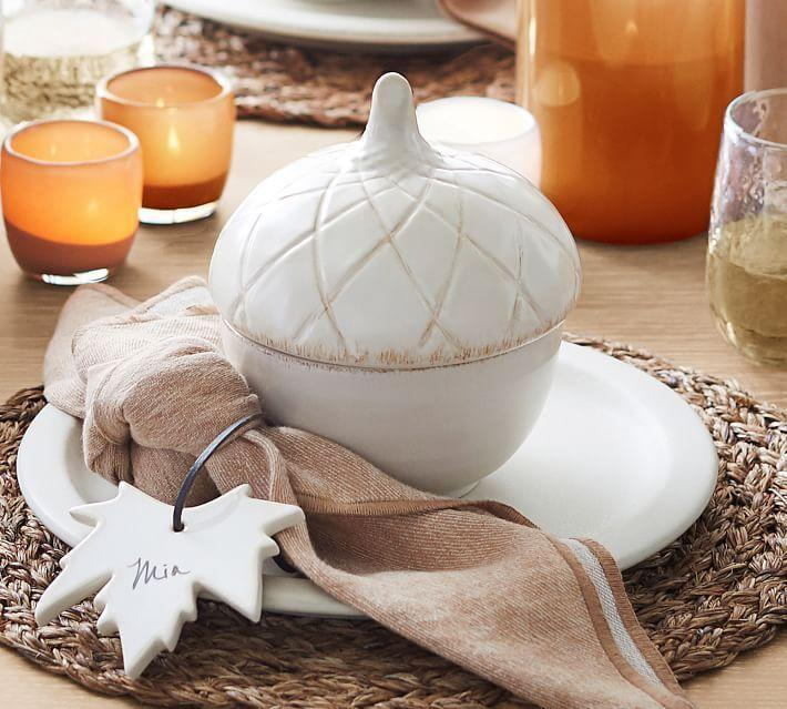 """<p>potterybarn.com</p><p><strong>$29.00</strong></p><p><a href=""""https://go.redirectingat.com?id=74968X1596630&url=https%3A%2F%2Fwww.potterybarn.com%2Fproducts%2Ffigural-acorn-lidded-soup-bowl%2F&sref=https%3A%2F%2Fwww.housebeautiful.com%2Fentertaining%2Fholidays-celebrations%2Fg11%2Fthanksgiving-table-setting-ideas-1011%2F"""" rel=""""nofollow noopener"""" target=""""_blank"""" data-ylk=""""slk:BUY NOW"""" class=""""link rapid-noclick-resp"""">BUY NOW</a></p><p>Step up your usual dinnerware by serving soups and other dishes in these acorn tureens. </p>"""