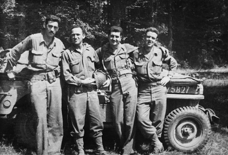 "This image released by The Weinstein Company shows author J.D. Salinger, left, after the Normandy invasion with his fellow counterintelligence officers from the film ""Salinger."" Harvey Weinstein is developing a feature film about J.D. Salinger to follow the recently released documentary. The Weinstein Co. announced the plans Wednesday, Sept. 18, saying the film will focus on the author's life between his World War II service and the publication of ""Catcher in the Rye."" The film will examine ""the effects war can have on an artist."" (AP Photo/The Weinstein Company)"