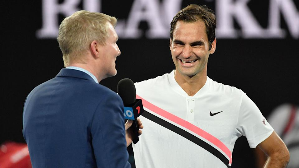 Jim Courier is seen here chatting with Roger Federer after an Australian Open match.