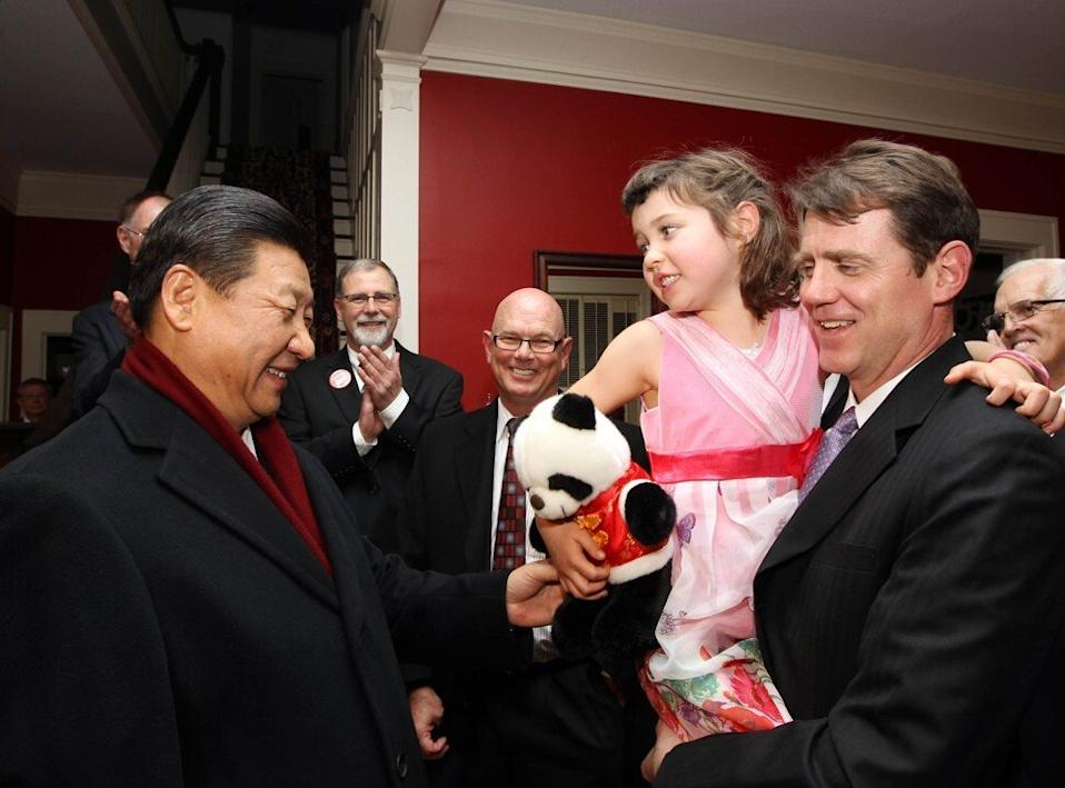 China's then vice-president Xi Jinping presents the granddaughter of his old friend Sarah Lande with a panda doll in Muscatine, Iowa, the United States, on February 15, 2012. Photo: Xinhua