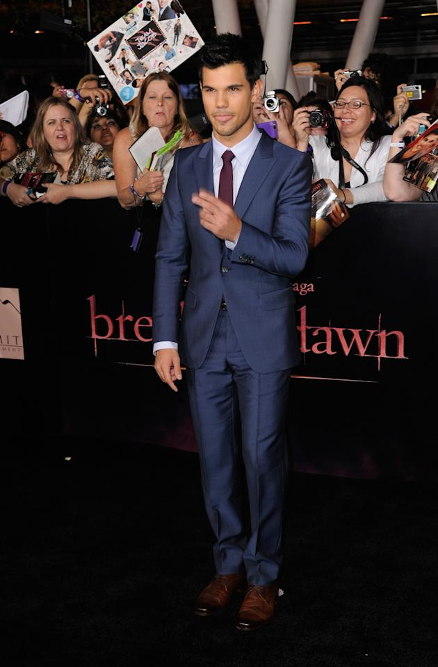 """LOS ANGELES, CA - NOVEMBER 14:  Actor Taylor Lautner arrives at Summit Entertainment's """"The Twilight Saga: Breaking Dawn - Part 1"""" premiere at Nokia Theatre L.A. Live on November 14, 2011 in Los Angeles, California.  (Photo by Frazer Harrison/Getty Images)"""