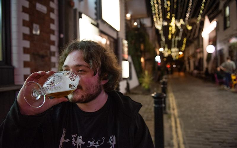 Ashton Lane in the West End of Glasgow would normally be packed with students as it is close to The University of Glasgow but last nights as pubs closed early very few people were seen around. September 25, 2020. Pic: Cameron Paterson, 20, fourth year student, enjoys a pint on a quiet Ashton Lane. - James Chapelard