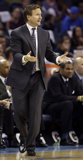 Oklahoma Thunder head coach Scott Brooks pleads for a call from the referees against the Charlotte Bobcats during the first half of an NBA basketball game in Charlotte, N.C., Friday, March 8, 2013. (AP Photo/Bob Leverone)