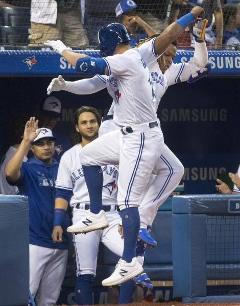 Toronto Blue Jays' Randall Grichuk, front, and Vladimir Guerrero Jr. celebrate after hitting back-to-back home runs against the Seattle Mariners during the third inning of a baseball game Friday, Aug. 16, 2019, in Toronto. (Fred Thornhill/The Canadian Press via AP)