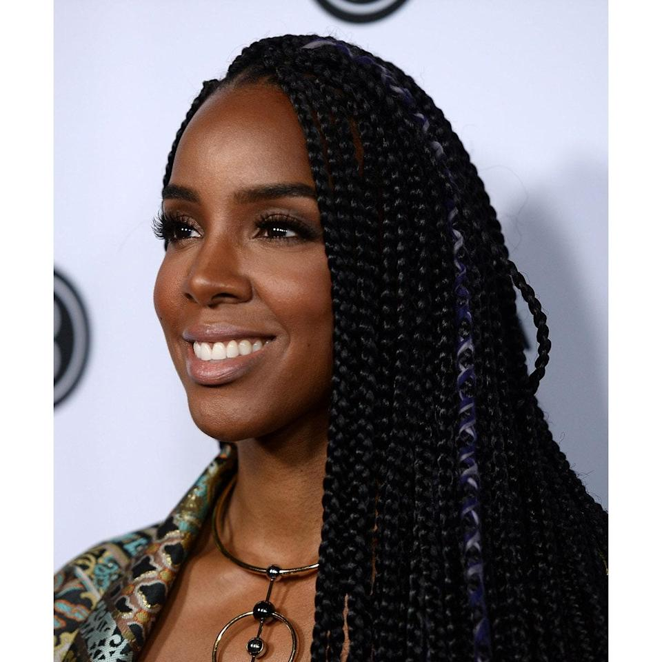 """Want to break up the uniformity of your box braids? """"A great way to revamp styles like box braids or faux locs is combining textures,"""" says Brown. """"It's a fun way to add color and turn a classic look into a new style."""" Add a few strands of colorful thread for some extra dimension."""