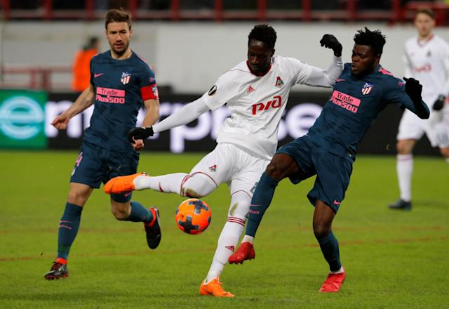 Soccer Football - Europa League Round of 16 Second Leg - Lokomotiv Moscow vs Atletico Madrid - RZD Arena, Moscow, Russia - March 15, 2018 Lokomotiv Moscow's Eder in action with Atletico Madrid's Thomas Partey REUTERS/Sergei Karpukhin