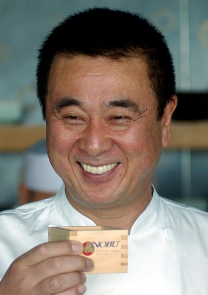 FILE - In this Jan. 10, 2007 file photo, celebrity Japanese chef Nobuyuki Matsuhisa smiles as he proposes a toast for his new restaurant Nobu, at a press availability in Hong Kong. Matsuhisa will be honored Saturday, Feb. 23, 2013, at the South Beach Wine and Food Festival for his fusion cuisine that blends Japanese and South American ingredients. (AP Photo/Lo Sai-hung, File)