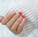 """Channel your favorite Fair Isle sweater with this cozy snowflake pattern. If you don't want to attempt free-handing the design, try these <a href=""""https://www.etsy.com/listing/895793829/snowflake-nail-stickers-adhesive-easy-to?ga_order=most_relevant&ga_search_type=all&ga_view_type=gallery&ga_search_query=snowflake+nail+decal&ref=sr_gallery-1-1&pro=1&frs=1"""" rel=""""nofollow noopener"""" target=""""_blank"""" data-ylk=""""slk:snowflake decals"""" class=""""link rapid-noclick-resp"""">snowflake decals</a>."""