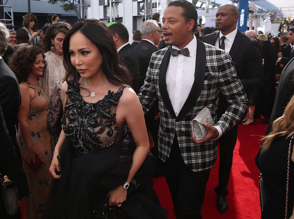 Mira Pak , left, and Terrence Howard arrive at the 68th Primetime Emmy Awards on Sunday, Sept. 18, 2016, at the Microsoft Theater in Los Angeles. (Photo by Matt Sayles/Invision for the Television Academy/AP Images)