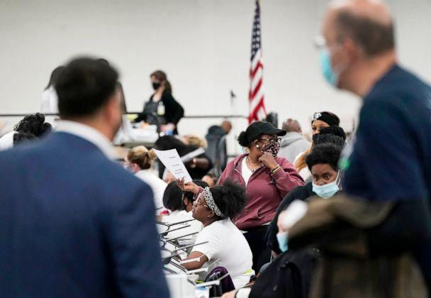 PHOTO:Election challengers observe as ballots are counted at the central counting board in Detroit, Nov. 4, 2020. (Carlos Osorio/AP, FILE)