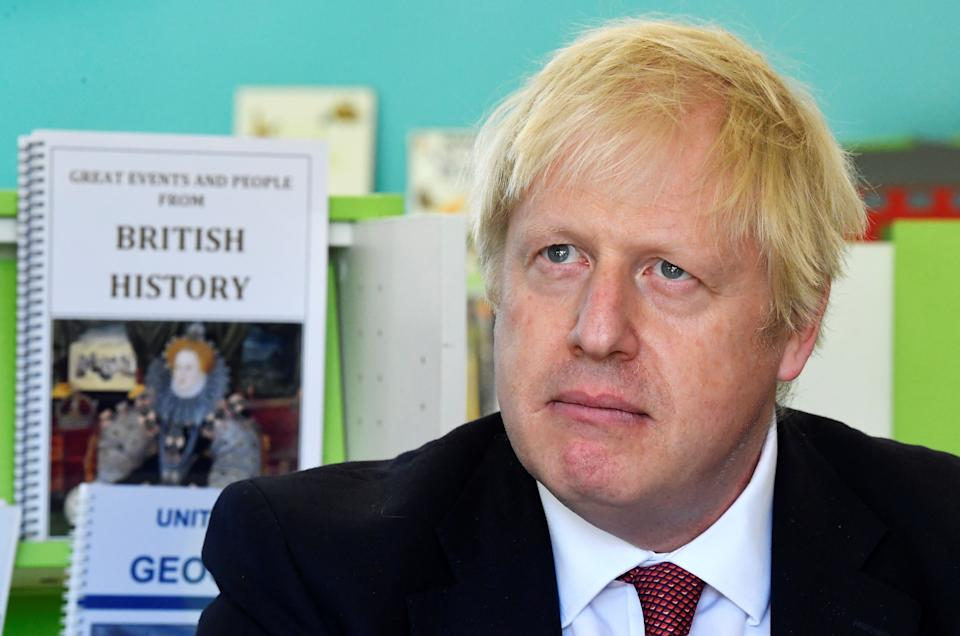 Britain's Prime Minister Boris Johnson speaks with year four and year six pupils during a visit to Pimlico Primary school in London