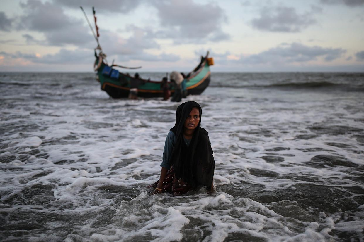 A Rohingya Muslim woman gets off a boat after crossing over from Myanmar into the Bangladesh side of the border, in Shah Porir Dwip near Cox's Bazar, Bangladesh on Sept. 13, 2017. Rohingya Muslims pay local fishers 36 U.S. dollars in order to cross to Shah Porir Dwip peninsula.