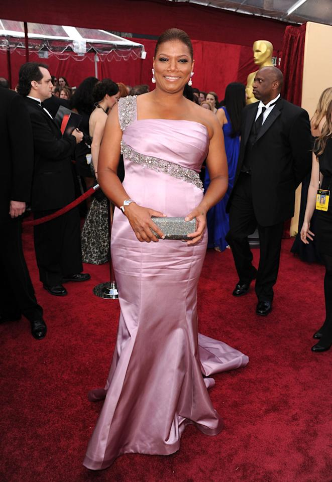 Queen Latifah   Grade: A    The Queen reigned supreme in a regal lavender figure-hugging satin gown, which she accessorized with diamonds and pink sapphires courtesy of Chopard.