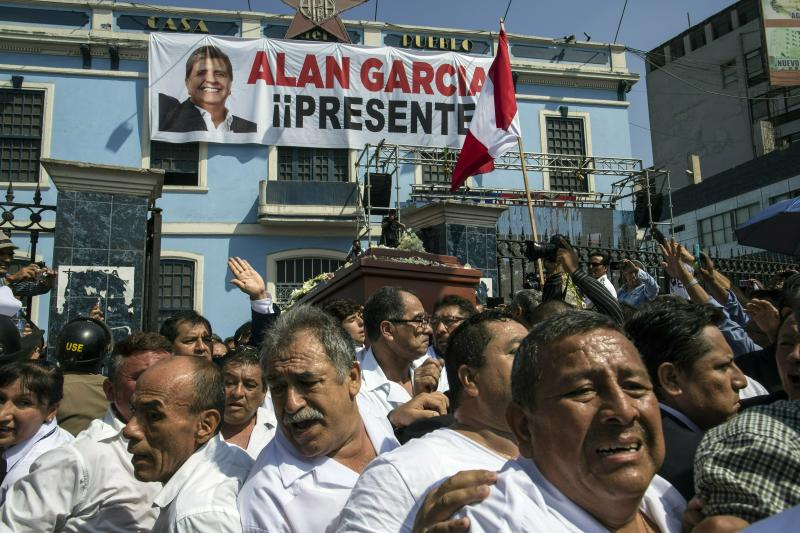 Men carry the coffin of Peru's late President Alan Garcia outside his party's headquarters where his wake was held, during his funeral procession in Lima, Peru, Friday, April 19, 2019. Garcia shot himself in the head and died Wednesday as officers waited to arrest him in a massive graft probe that has put the country's most prominent politicians behind bars and provoked a reckoning over corruption. (AP Photo/Rodrigo Abd)