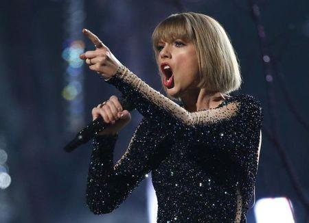 """FILE PHOTO - Taylor Swift performs """"Out of the Woods"""" at the 58th Grammy Awards in Los Angeles"""