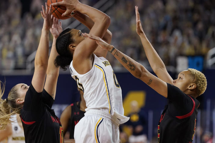 Michigan forward Naz Hillmon (00) attempts a shot as Maryland guard Faith Masonius, left, and forward Alaysia Styles defend during the first half of an NCAA college basketball game, Thursday, March 4, 2021, in Ann Arbor, Mich. (AP Photo/Carlos Osorio)