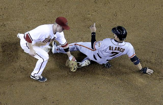 San Francisco Giants' Gregor Blanco, right, steals second as Arizona Diamondbacks' Aaron Hill applies the late tag during the fifth inning of a baseball game on Friday, June 20, 2014, in Phoenix. (AP Photo/Matt York)