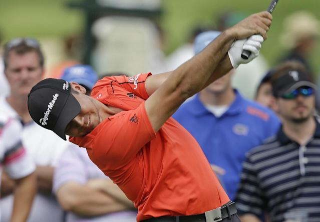 Jason Day, of Australia, tees off on the 15th hole during the first round of the Memorial golf tournament Thursday, May 29, 2014, in Dublin, Ohio. (AP Photo/Darron Cummings)