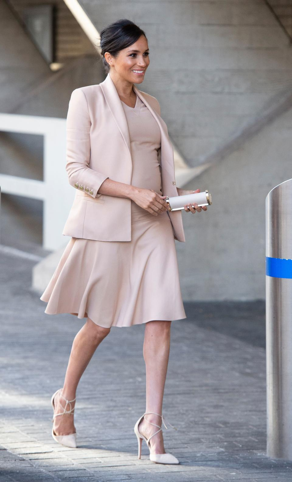 For a trip to the National Theatre in London, the Duchess of Sussex wore a dress and co-ordinating blazer by Brandon Maxwell. To accessorise the ensemble, the royal chose a Carolina Herrera clutch bag with lace-up Aquazurra heels – which she first wore on her engagement photo call. [Photo: Getty]