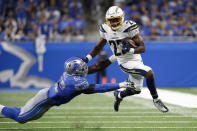 Los Angeles Chargers running back Justin Jackson (22) runs the ball as Detroit Lions outside linebacker Christian Jones (52) defends in the second half of an NFL football game in Detroit, Sunday, Sept. 15, 2019. (AP Photo/Rick Osentoski)