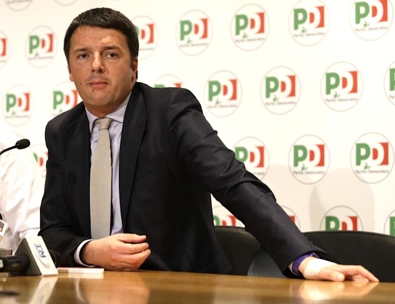Newly elected PD, Democratic Party secretary general Matteo Renzi answers to journalists questions during a press conference he held at Rome's party headquarters, Monday, Dec. 9, 2013. (AP Photo/Andrew Medichini)