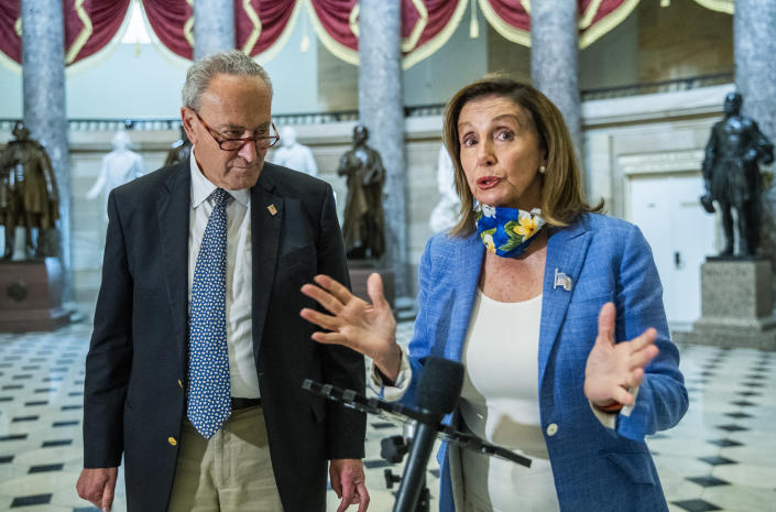 Senate Minority Leader Chuck Schumer and House Speaker Nancy Pelosi, following a meeting with White House chief of staff Mark Meadows and Treasury Secretary Steven Mnuchin on a COVID-19 relief bill on Saturday. (Manuel Balce Ceneta/AP)
