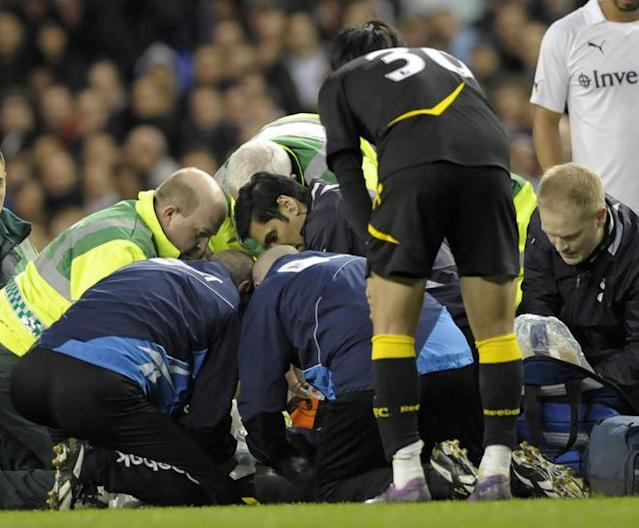 "Bolton's English midfielder Fabrice Muamba is treated by medical staff after collapsing during the English FA Cup quarter-final football match between Tottenham Hotspur and Bolton Wanderers at White Hart Lane in north London, England on March 17, 2012. The game was abandoned at half-time as Muamba was taken to hospital. RESTRICTED TO EDITORIAL USE. No use with unauthorized audio, video, data, fixture lists, club/league logos or ""live"" services. Online in-match use limited to 45 images, no video emulation. No use in betting, games or single club/league/player publications (Photo by Olly Greenwood/AFP/Getty Images)"
