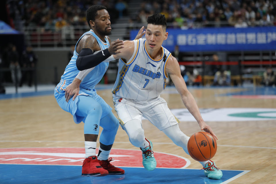 Jeremy Lin of the Beijing Ducks and Kay Felder of the Xinjiang Yilite in action during at Beijing Wukesong Sport Arena on December 25, 2019 in Beijing, China.