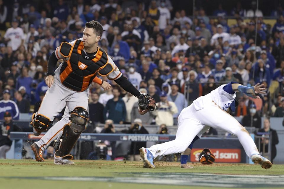 San Francisco Giants catcher Buster Posey tags out Dodgers' Gavin Lux at home.