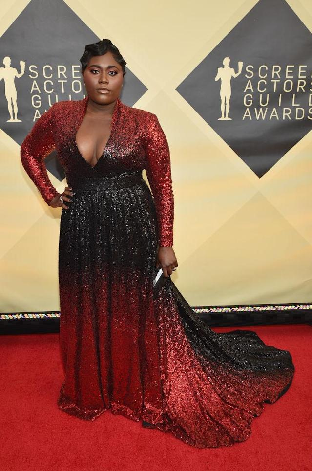 <p>The actress wore finger-waved hair with an ombre black and red sequined gown. (Photo: Getty Images) </p>