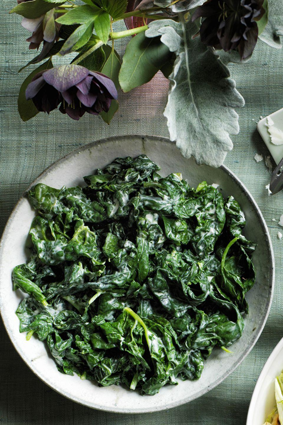 """<p>Because a little bit of cheese makes everything better, especially to plain spinach.</p><p><em><strong><a href=""""https://www.womansday.com/food-recipes/food-drinks/recipes/a60487/creamy-garlic-and-herb-spinach-recipe/"""" rel=""""nofollow noopener"""" target=""""_blank"""" data-ylk=""""slk:Get the Creamy Garlic and Herb Spinach recipe."""" class=""""link rapid-noclick-resp"""">Get the Creamy Garlic and Herb Spinach recipe.</a></strong></em></p>"""