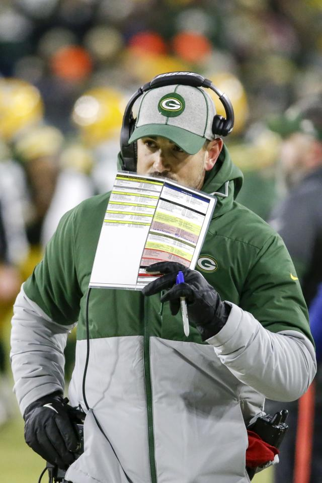 Green Bay Packers head coach Matt LaFleur calls a play during the first half of an NFL divisional playoff football game against the Seattle Seahawks Sunday, Jan. 12, 2020, in Green Bay, Wis. (AP Photo/Mike Roemer)