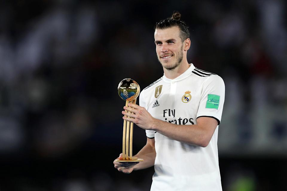 Gareth Bale of Real Madrid poses with his Adidas Golden Ball award after the FIFA Club World Cup UAE 2018 Final between Al Ain and Real Madrid.