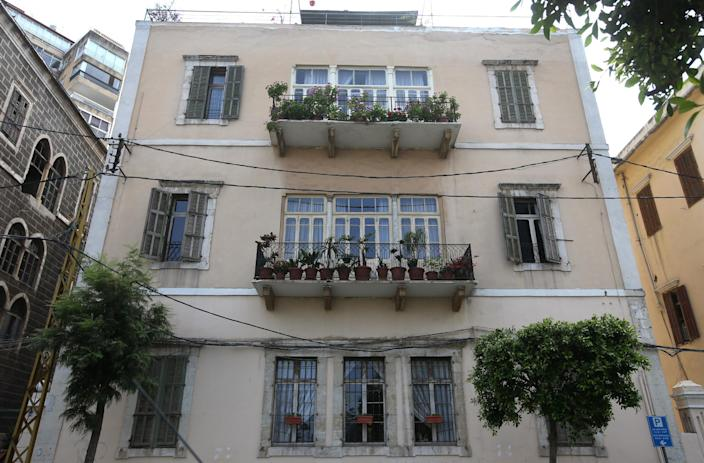 In this April 8, 2014 photo, an old traditional building is threatened with demolition to make way for a controversial highway through a historic quarter, in Beirut, Lebanon. Lebanon's booming real estate sector has led to the destruction of hundreds of traditional Lebanese houses known for their stoned, arched headways, elaborate balconies and colorful windows and gardens. (AP Photo/Hussein Malla)